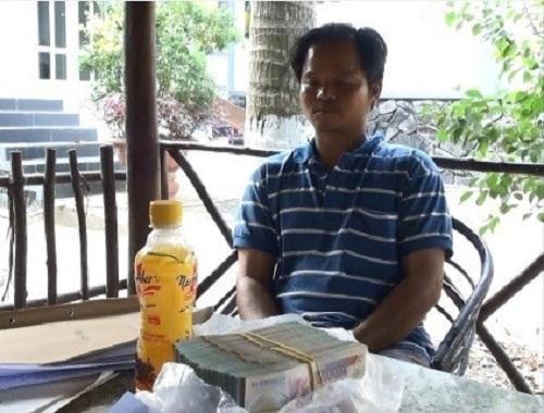 Ông Võ Văn Minh bị bắt ngày 27/1 khi đang nhận 500 triệu đồng từ Tân Hiệp Phát